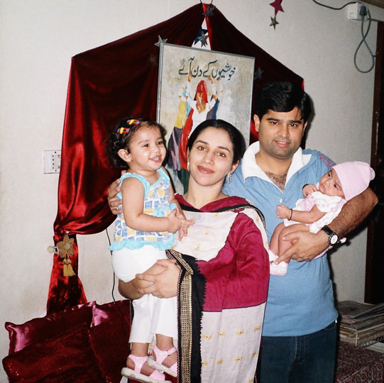 Kamran with his wife and kids