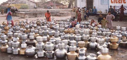 EMPTY POTS QUEUED UP IN LONG WAIT