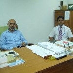 Dr. Saqib Riaz with a colleague in his office