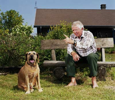 Senior man talking to a dog