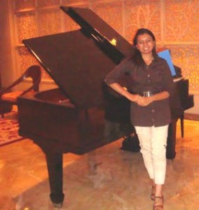 Devanshi Joshi with a Piano