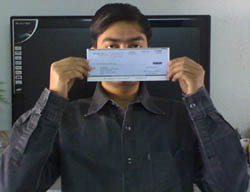 Uttoran Sen with his online earning's check