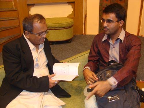 Sanjay Goradia taking a look at SpeakBindas book