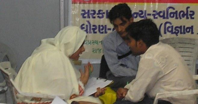 Farida H. Bharmal doing the Handwriting analysis