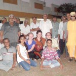 Exchange students and AFS Rajkot volunteers with male residents of Mavtar Vrudhashram Old Age Home