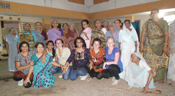 Exchange students and AFS Rajkot volunteers with female residents of Mavtar Vrudhashram Old Age Home