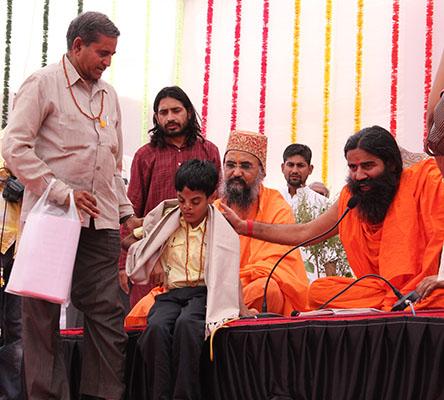 Uttam Maru with Baba Ramdevji.