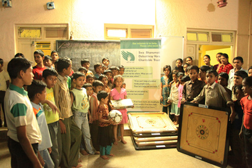 "Kids of ""Happy Home"" with instruments of fun, donated by SBDVCT"