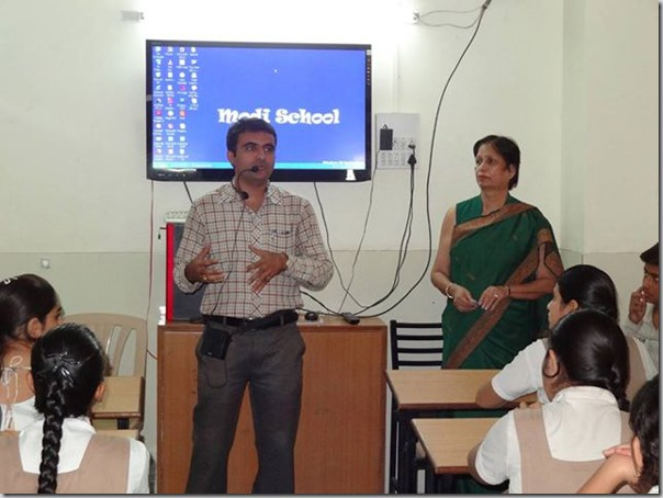 Devang Vibhakar Giving Information about AFS organization at V J Modi school